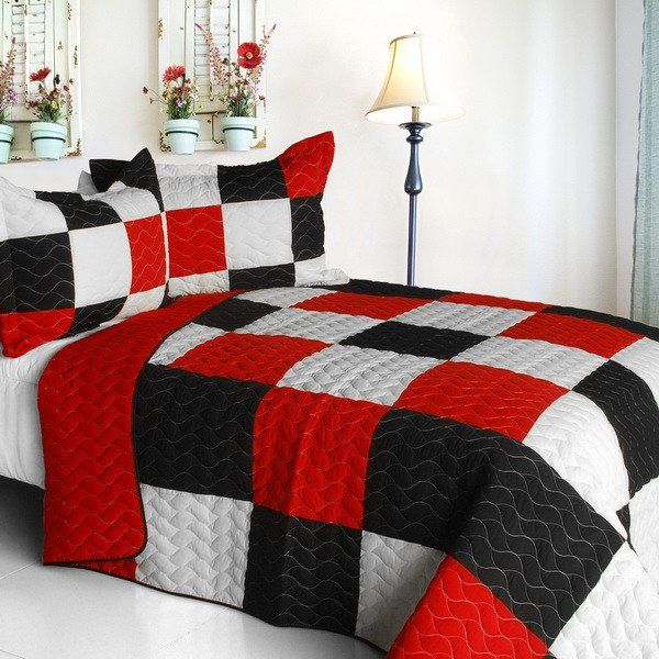 Red and Black Patchwork Quilt for a King-Sized Bed