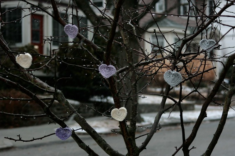 Crocheted mini hearts on the tree
