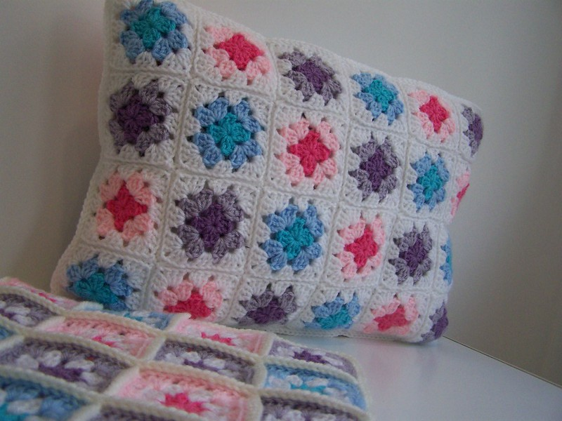 purple and pink crochet pillow cover