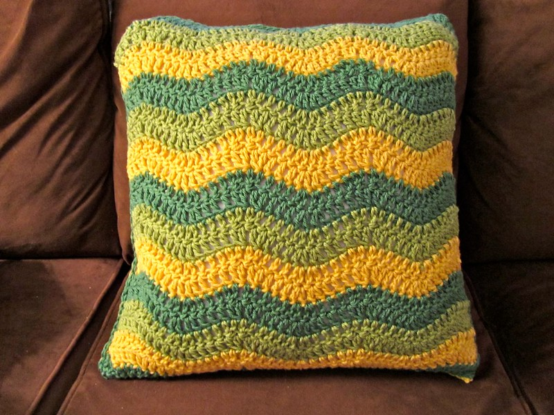 green and gold crochet pillow cover