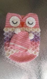 Crochet baby cocoon with stuffed animal